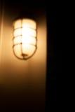 Unscharfe Wandlampe Stockfotografie