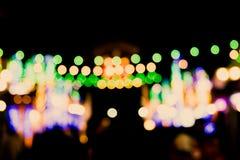 Unscharfer Defocussed-Zusammenfassungs-Hintergrund eines Nachtmarktes Lizenzfreie Stockbilder