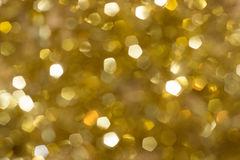 Unscharfer Goldschein Lizenzfreie Stockbilder