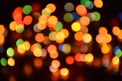 Unscharfer Hintergrund, bokeh mit bunten Lichtern, festliche Beleuchtung Stockfotografie