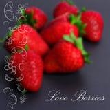 Unscharfer Hintergrund mit Erdbeere Stockfotos
