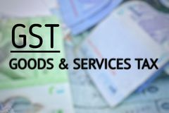Unscharfer Hintergrund mit GST-Text Lizenzfreie Stockfotos