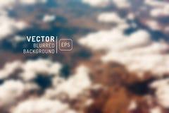 Unscharfer Vektorhintergrund Für Auslegung Wolken, Erde und eine Spitze V Lizenzfreie Stockbilder