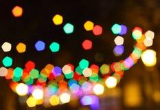 Unscharfer Weihnachtsleuchtehintergrund Stockbild