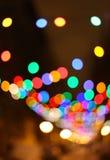 Unscharfer Weihnachtsleuchtehintergrund Stockfotografie