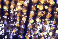 Unscharfes abstraktes Licht der Luxuslampe nachts für Partei- oder Feierhintergrund Stockfotografie