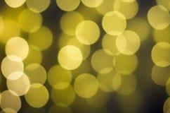 Unscharfes bokeh Licht im warmen Tonhintergrund Stockfoto