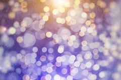 Unscharfes bokeh Licht im warmen Tonhintergrund Lizenzfreies Stockfoto