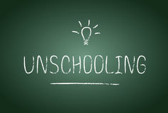 Unschooling. Lettering in vector. Chalk board and chalk effect. Free education and study at home Stock Photography