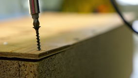 Unscrew the screw slow motion. Screwdriwdriver unscrew the screw on wooden boxes stock footage