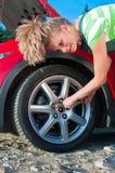 Unscrew the wheel Stock Image