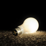 Unscrewed Glowing Light Bulb Royalty Free Stock Photography