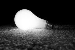 Unscrewed Glowing Light Bulb Stock Photography