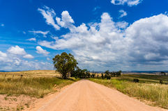 Unsealed rural dirt road Stock Photo