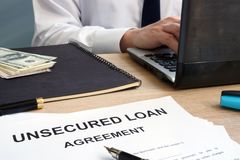 Unsecured loan form in an office. Unsecured loan form in the office royalty free stock photography