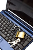 Unsecured notebook. Notebook with opened lid and unlocked locker on top of keyboard. Lock your computer or protect your data for safety reasons Stock Photos