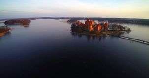 Unseen Lithuania. The castle of Trakai aerial view flight from above, famous Lithuanian places bird's eye view stock footage