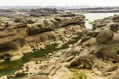 Unseen Thailand landscape view of Rock holes Stone in Sam-Pan-Bok Grand Canyon or the mekong river in thai grand canyon with sunri Stock Image