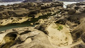Unseen Thailand landscape view of Rock holes Stone in Sam-Pan-Bok Grand Canyon or the mekong river in thai grand canyon with sunri Stock Images