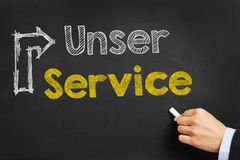 Unser Service in German with arrow on blackboard Stock Photo