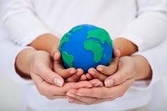 Unser Vermächtnis zu den nächsten Generationen - eine saubere Erde Stockbild