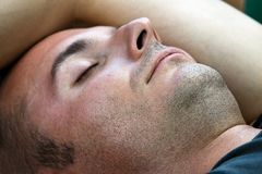 Unshaved and sleeping Stock Images