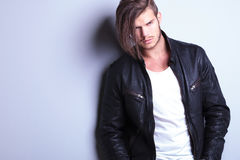 Unshaved young fashion model in leather jacket Royalty Free Stock Photos