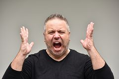 Unshaven Adult Male Under Stress. An overweight and adult male Royalty Free Stock Photos