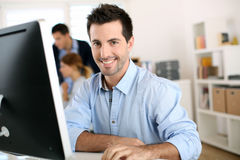 Unshaven Business Man At Work In Office Stock Image