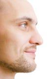 Unshaven junger Mann des Gesichtes im Profil Stockfotos