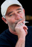 Unshaven Man Smoking Cigarette Royalty Free Stock Image