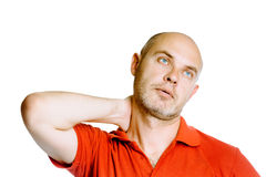 Unshaven middle-aged man holding his neck. Pain. Studio. isolate Royalty Free Stock Images