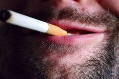 Unshaven smoker. Close up of unshaven smoker Stock Photo