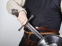 Unsheating a medieval sword Royalty Free Stock Photos
