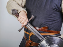 Unsheating a medieval sword Royalty Free Stock Photo