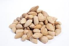 Unshelled Almonds. Many Unshelled Almonds on white Stock Photos