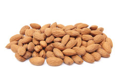 Unshelled almonds. Closeup image of unshelled almonds isolated on a white background Royalty Free Stock Photography