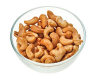 Unshelled cashew nuts in a glass bowl Stock Images