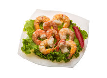 Unshelled king prawn. Heap with salad leaves Royalty Free Stock Image