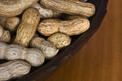 Closeup of peanuts. A close-up of unshelled peanuts in a wooden blowl Royalty Free Stock Image