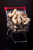 Unshelled peanuts in the supermarket trolley Stock Photo