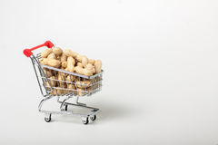 Unshelled peanuts in the supermarket trolley Royalty Free Stock Photos