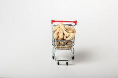 Unshelled peanuts in the supermarket trolley Stock Photography