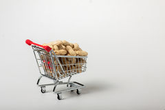 Unshelled peanuts in the supermarket trolley Stock Photos