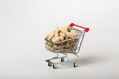 Unshelled peanuts in the supermarket trolley Royalty Free Stock Photo
