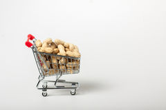 Unshelled peanuts in the supermarket trolley Royalty Free Stock Photography