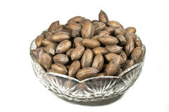 Unshelled Pecan Nuts in Decorative Glass Bowl Royalty Free Stock Photos