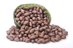 Unshelled Pecan Nuts Spilling from Zulu Beaded Basket Stock Image