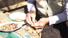 Unshelled and Peeling Walnuts ,  Version 1. Unshelled and Peeling Walnuts by Granny's Hands.A walnut is the nut of any tree of the genus Juglans (Family stock video footage