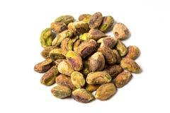 Unshelled pistachios. On a white background Royalty Free Stock Photos